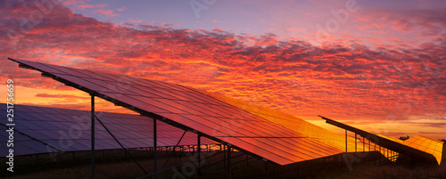Fototapeta Solar power plant on the background of dramatic, fiery sky at sunset,Germany obraz