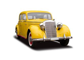 Żółty Niemiecki antykwarski samochód odizolowywający na bielu
