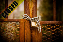 Rusty Metal Gate Of A Factory Closed With Padlock - Concept Image With Closed Text On It