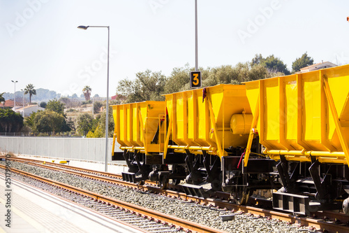 Ballast train. A large cargo yellow train at the station Canvas Print