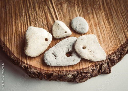 Canvas-taulu Sacred hag stones-natural stones with a natural hole through, believed to be sacred