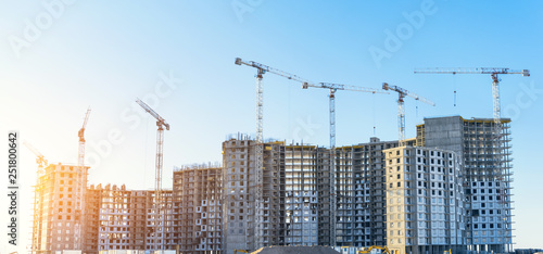 Fotografie, Obraz Large residential complex real estate apartments, under construction with high cranes