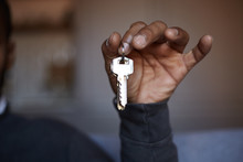 African Black Man Holding Home Keys In Hand.
