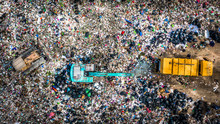 Garbage Pile  In Trash Dump Or Landfill Abundance, Aerial View Garbage Truck Unload Garbage To A Landfill,  Biohazard Global Warming Ecosystem And Healthy Environment Concept.