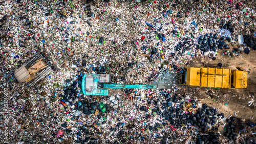 Fotografía  Garbage pile  in trash dump or landfill, Aerial view garbage trucks unload garbage to a landfill,  global warming