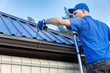 canvas print picture - metal roofing - roofer working on the house roof