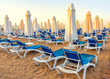 sandy beach to sea with sun beds and folded umbrellas, Turkey, Side resort