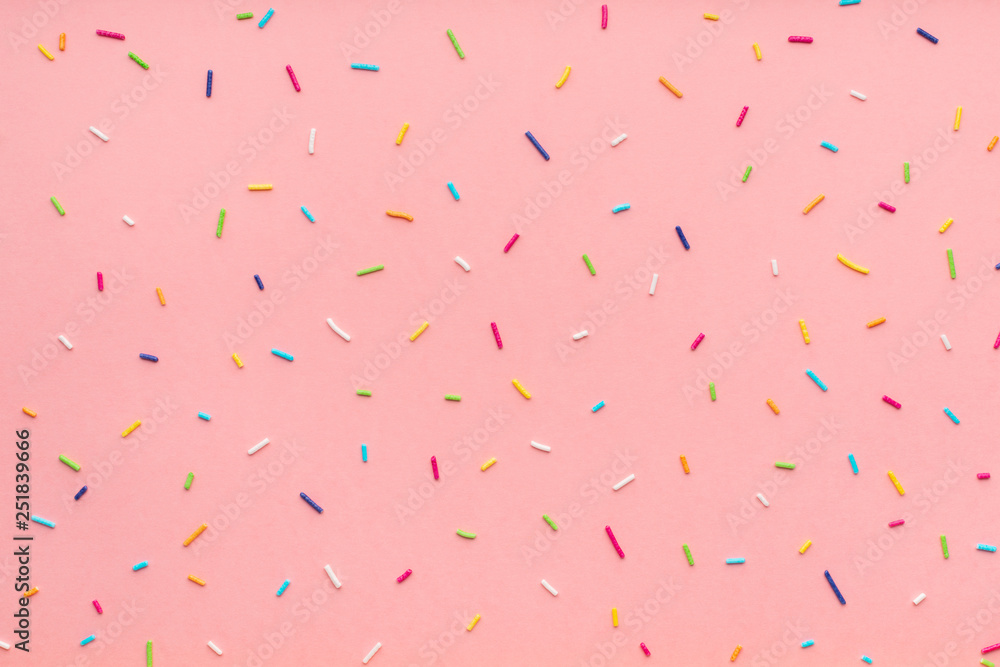 Fototapeta trendy pattern of colorful sprinkles for background of design banner, poster, flyer, card, postcard, cover, brochure over pink