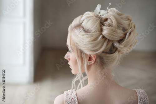 Portrait of a blonde bride with an elegant wedding hairstyle in profile.