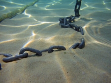 Seabed With Sand And Anchor Chain, Close Up