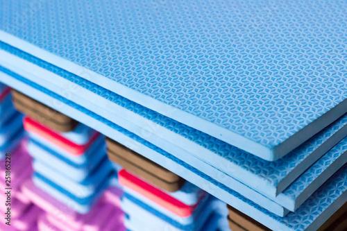 Valokuva Multicolored EVA foam puzzle mats stacked