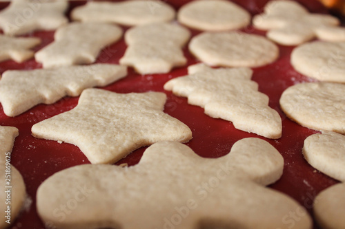 Fotografie, Obraz  Perspective View of Warm Sweet Christmas Holiday Cut Out Sugar Cookies with Whit
