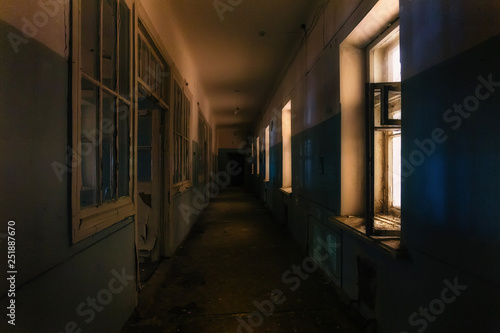Fototapeta Dark creepy corridor of abandoned hospital at night