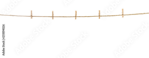 Fotografía  Clothespins hanging on clothesline with space for your text.