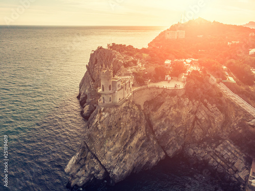 Foto op Aluminium Oranje Swallow Nest, ancient castle on top of mountain cliff near sea Yalta region at sunset, Crimea. Beautiful famous palace architecture and amazing nature landscape, aerial view from drone