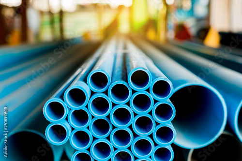 Fotografia  Close up to blue plastic pipe background, PVC pipes stacked in warehouse,  PVC w