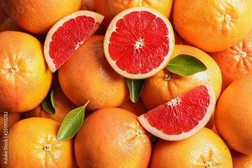 Fotografía Many fresh ripe grapefruits as background, top view