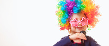 Funny Image Of Little Cute Child Girl Wearing Sunglasses With Colorful Wig Singing In Microphone On White Background. Singer Talent And Vocal Training Concept.