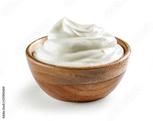 Obraz na plátně sour cream in wooden bowl