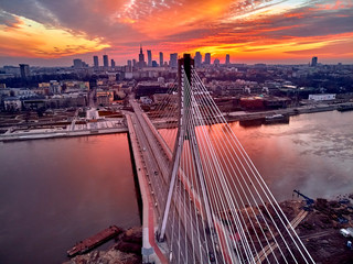 FototapetaBeautiful panoramic aerial drone sunset view to Warsaw city center with skyscrapers and Swietokrzyski Bridge (En: Holy Cross Bridge) - is a cable-stayed bridge over the Vistula river in Warsaw, Poland