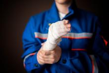 Injured Worker In Uniform Isolated On Dark Background B