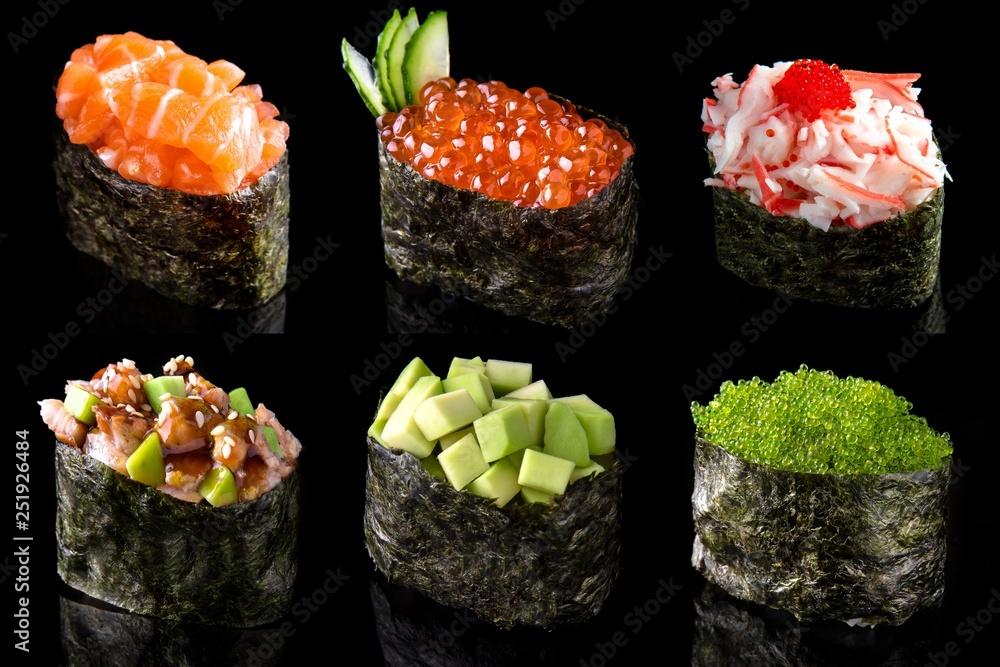 Fototapety, obrazy: Set sushi gunkan from salmon, caviar, tuna, shrimp, avocado and smoked eel on black background. Traditional Japanese cuisine