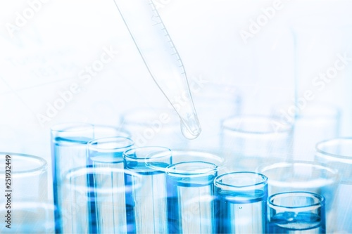 Science laboratory test tube and pipet with drop, laboratory equipment closeup Canvas Print
