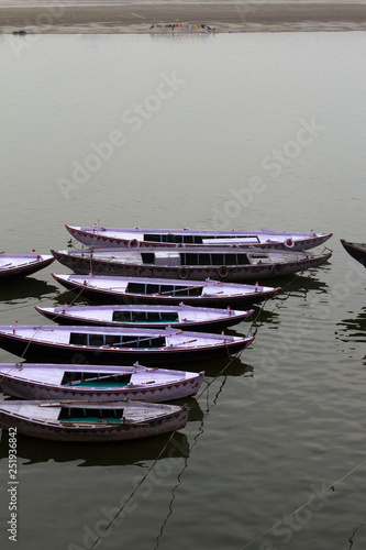 Fotografie, Obraz  Typical two-way boats on the Ganges river