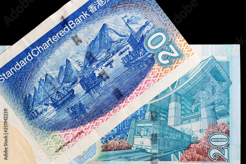 Photo  Three different bills in twenty Hong Kong dollars on a dark background close up