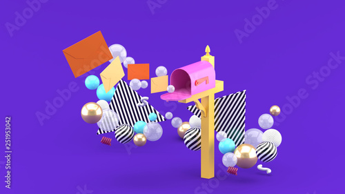 Photo A floating letter from a mailbox surrounded by colorful balls on a purple background