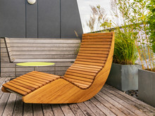 Rocking Lounger On A Roof Terrace With Bamboo And Grasses