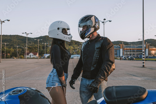 Girl and guy bikers love each other Canvas-taulu