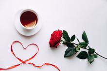 Red Rose On A White Background, Ribbon In The Heart Of Ide By March 8