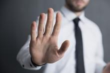 Man Hand Stop Sign