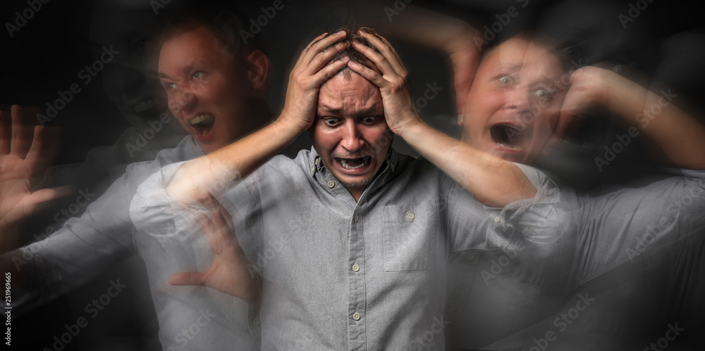 Fototapeta Man having panic attack on dark background
