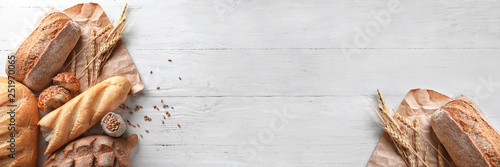 Fotografia, Obraz Different bakery products on wooden background
