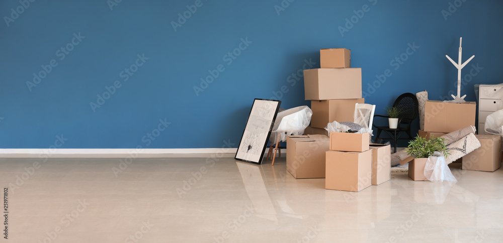 Fototapety, obrazy: Carton boxes and interior items prepared for moving into new house near color wall