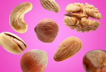 Falling Nuts On Color Background