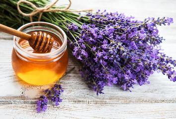 Fototapeta Lawenda Jar with honey and fresh lavender