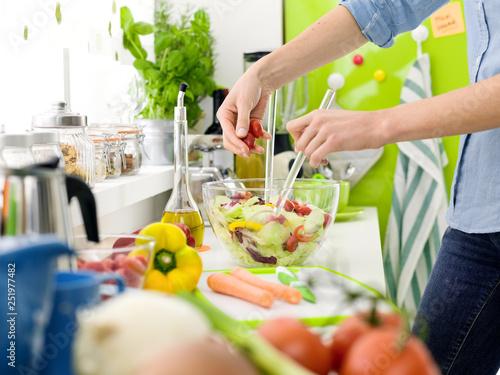 Fototapeta  Woman preparing a fresh healthy salad