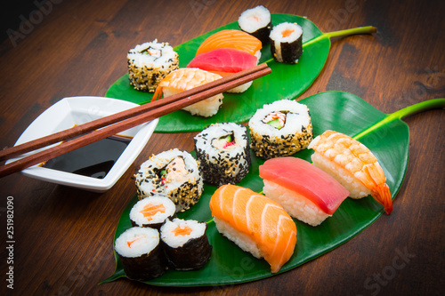 mixed sushi on green leaf