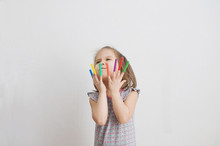 Child Playing With Felt Tip Pens Stuff. Baby Girl Painting And Playing. Colorful Felt Pen Caps On Fingers Of Kid