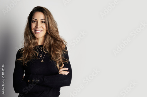 Fotografia  Handsome happy businesswoman isolated on white background
