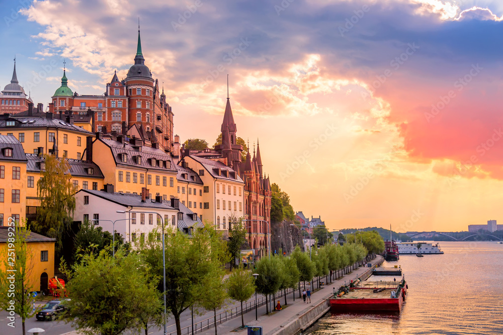 Fototapety, obrazy: Stockholm, Sweden. Scenic summer sunset view with colorful sky of the Old Town architecture in Sodermalm district.