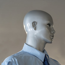 Head Of A Bald Mannequin With A Shirt On
