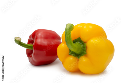 Fotografía  yellow and red sweet bell pepper on white background