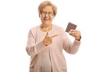 Elderly Woman Holding A Chocol...