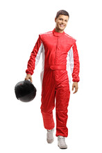 Male Car Racer Holding A Helmet And Walking Towards The Camera