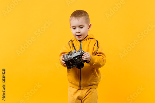 Little kid boy 3-4 years old wearing yellow clothes hold