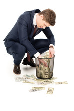 Young Businessman Taking Money...